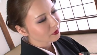 This warm big tits Japanese MILF is showing off quite a lot of what many of us like