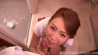 Japanese bitch homemaker on her knee joints milking a shaft