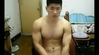 Strapping Oriental chunk takes off his clothing and bad boys off his cock