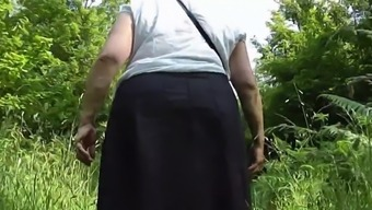 Upskirt bum in the wood substrates Piece One.mp4