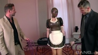 Meek buxom maid Lucy Latex is gonna please her supervisor with his fantastic kinky friend