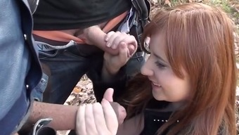 Slutty red-haired Swedish player posh gives twofold blowjob outdoor