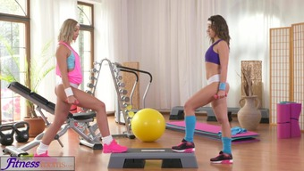 FitnessRooms Attractive lesbians get extreme warm in the fitness center