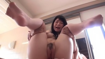 Asian vagabond by using genuine boobs gives a blowjob and titjob