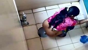 Indian girls filmed on secret cam inside a masses bathroom