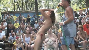 A bunch of crazy females get naked and start having dancing lessons when it comes to the video camera