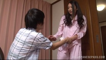 A charming Japanese people homemaker gives her man a handjob