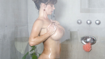 Big tits MILF twiddling with her pussy in shower