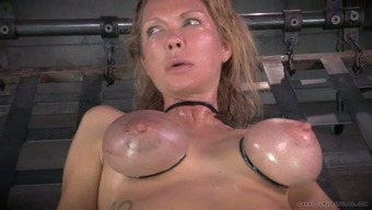 Great breasted mothers by using nipple clamps on and gets her muff toyed