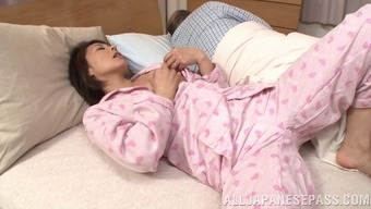 Short haired From asia companion ring fingers herself while her hubby sleeps