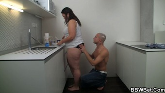 He fucks BBW at the home kitchen