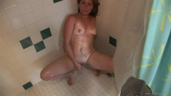 Arrogant newbie cougar independently version with organic tits petting her bald pussy within a moist shower act