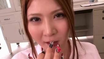 Japanese people clinician Momoka Nishina gets facialized within a bukkake sitting
