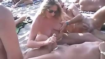Merely a cute nudist seashore combination of attractive couples