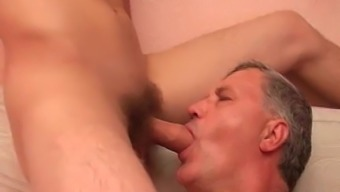 Old hunk twiddling with youngster cocks