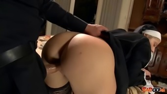 Sexy nun in dark colored stockings fucked via the priest