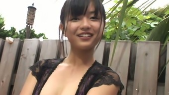 Raven haired From asia gorgeous Mayumi Yamanaka enjoys webcam while you're in the shower