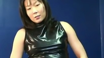 Sexy Natural MILF in latex gown twiddling with her pussy