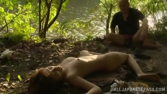 Japanese milf Mei gets her cherry fucked from behind open air