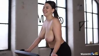 Stylish raven haired nasty person Scarlet Blush shakes her delicious boobs while you are using physical training machine