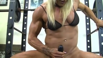 Muscle Baby Fucks a Dildo in the fitness center