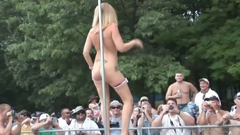 Attractive blonde in footware performances along at the stripper dick outside