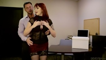 Sexy red haired desk Tawny-gold Ivy can help her person-in-charge to eradicate tension