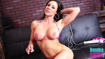 Milf Kendra Lust with large titties brushing pussy seductively