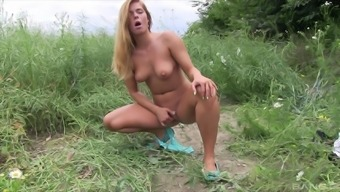Good looking Chrissy Fox exposes her body by stripping outdoors