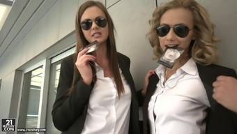 Two police officers Tina Kay and Veronica Leal take care of a dick