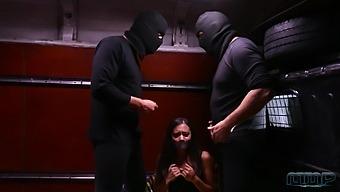 Ukrainian bitch Shrima Malati is fucked by two robbers in black masks