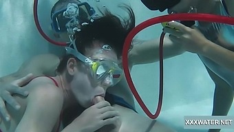 Blowjob expert Minnie Manga and her best girlfriend suck a dick under the water