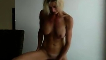 Blonde milf with a standing masturbation