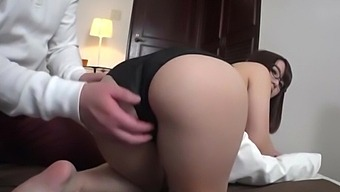 Passionate fucking on the bed with a cute Asian girl with glasses