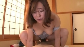 Horny Asian chick moans loudly while riding a friend's pecker