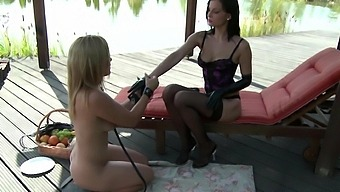 Outdoors video of BDSM lesbian sex - Abbie Cat and Valentina Blue