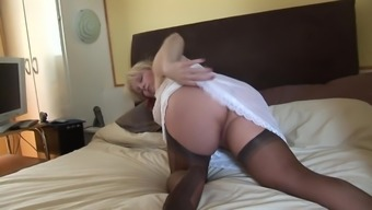 Busty mature blonde in utter pantyhose fall and stockings