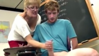 Shorthaired blond gilf teacher strokes his challenging cock