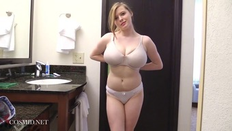 Attractive brown young adult babe has really large boobs