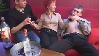 Over the course of party a redheaded MILF takes on four males at one time