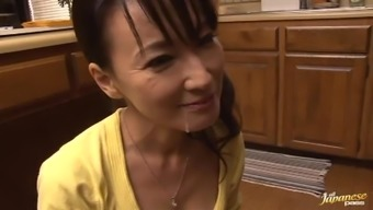 Fascinating Age Japanese Giving a great Blowjob in the cooking area