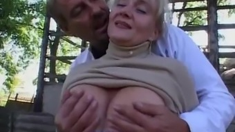 Granny gets fucked among the outdoor setting